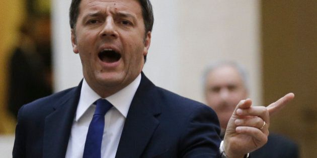 Italian Prime Minister Matteo Renzi, left, gestures as he waits for Afghan President Ashraf Ghani at...