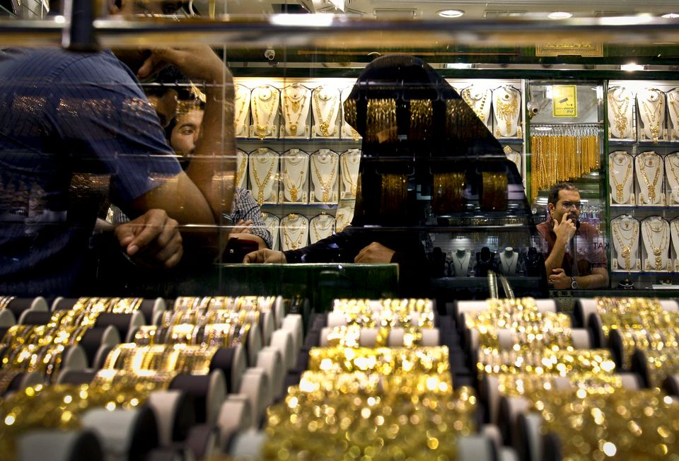 In this Thursday Oct. 11, 2012 photo, an Emirati woman discusses her purchases with a salesman at a jewelry shop in gold suq