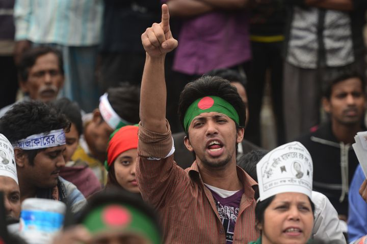 A Bangladeshi youth shouts slogans as Bangladeshi social activists and bloggers participate in a demonstration demanding the
