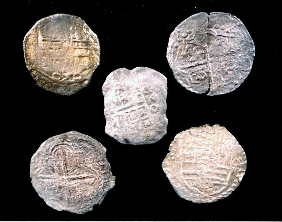 Five Mexico City and Peruvian silver coins from the Tortugas shipwreck.