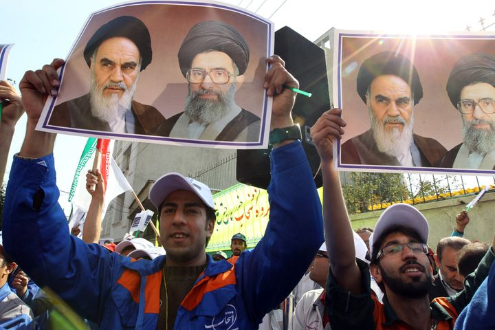 Workers of Iran's Entekhab Industrial Group hold portraits of late founder of Islamic republic, Ayatollah Ruhollah Khomeini (