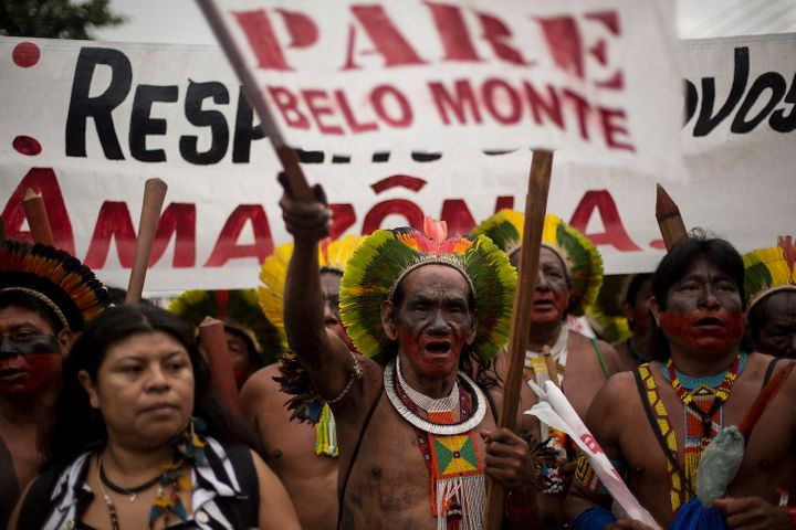 RIO DE JANEIRO, BRAZIL - JUNE 20: Brazilian indigenous, during an indigenous march against the hydroelectric of Belo Monte in the surroundings of RioCentro convention center, where the UN Conference on Sustainable Development is being , on June 20, 2012 in Rio de Janeiro, Brazil. (Photo by Buda Mendes/LatinContent/Getty Images)