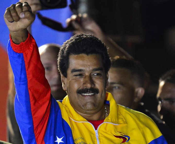 Venezuelan President elect Nicolas Maduro celebrates following the election results in Caracas on April 14, 2013. Fireworks e