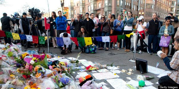 BOSTON, MA - APRIL 17: Two days after the tragedy, a makeshift memorial is growing on Boylston Street at a roadblock near the