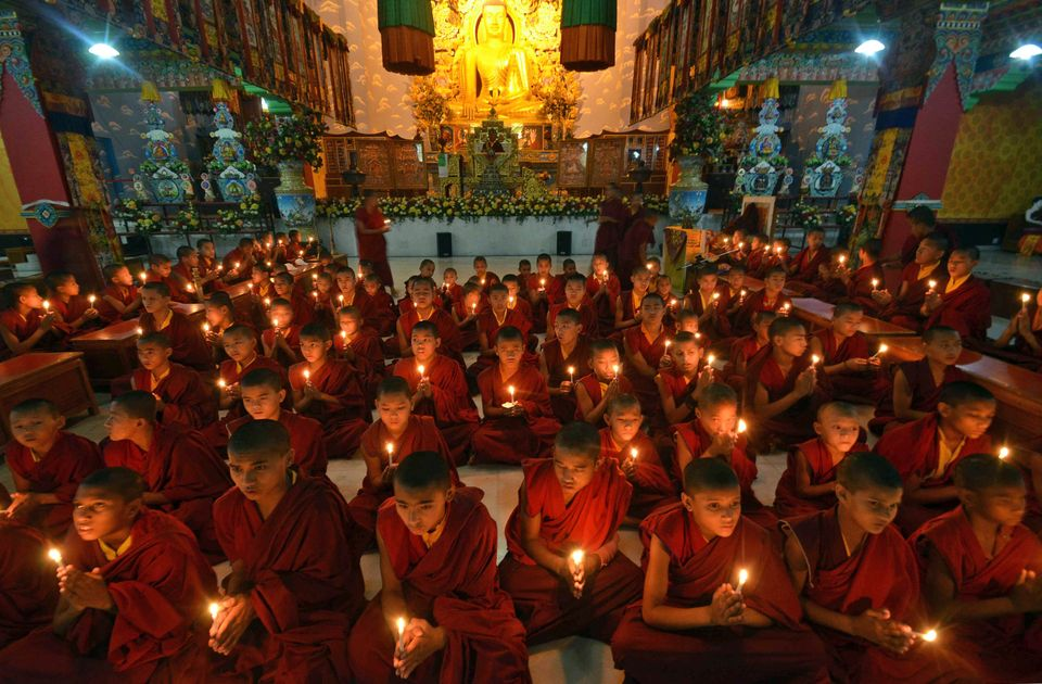 Young Buddhist monks pray for the speedy recovery of a 5-year-old girl who was raped and tortured in Delhi, in Bodhgaya, Indi
