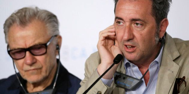 Director Paolo Sorrentino, right, speaks alongside Harvey Keitel during a press conference for the film...