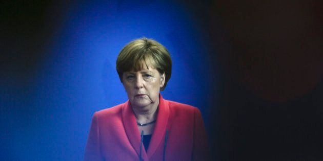German Chancellor Angela Merkel briefs the media after a meeting with leaders of all parties represented...