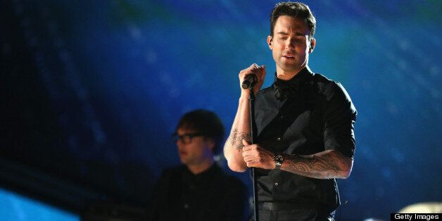 LOS ANGELES, CA - FEBRUARY 10:  Singer Adam Levine of Maroon 5 performs onstage during the 55th Annual GRAMMY Awards at STAPL