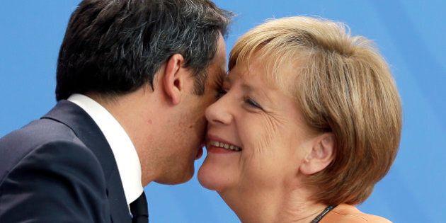 German Chancellor Angela Merkel, right, hugs the Prime Minster of Italy, Matteo Renzi, left, after a...