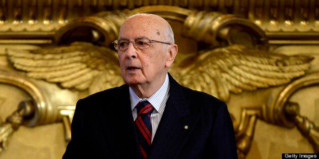Italian President Giorgio Napolitano looks on during the swearing in ceremony of the new government at the Quirinale Palace i