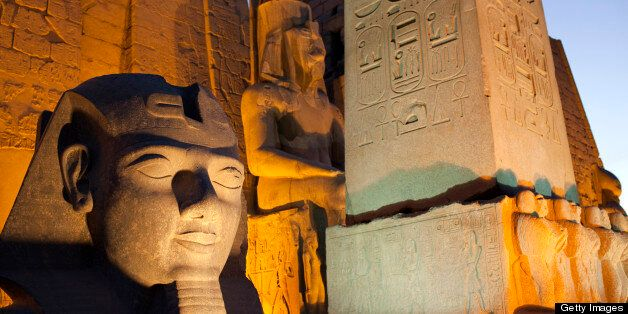Ancient monuments stand illuminated in the evening at the Temple of Luxor in Luxor, Egypt, on Wednesday, April 24, 2013. Egyp