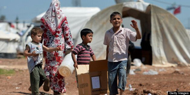 Internally displaced Syrian families spend their day at the Maiber al-Salam refugee camp along the Turkish border in the nort