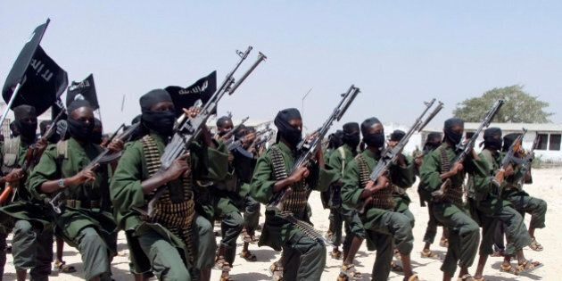FILE---In this file photo of Thursday, Feb.17, 2011, Hundreds of newly trained Shabaab fighters perform...