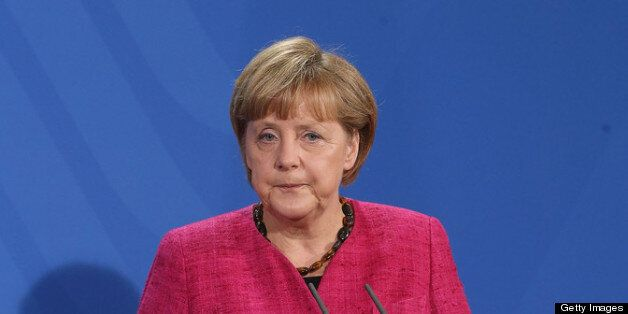 BERLIN, GERMANY - APRIL 30:  German Chancellor Angela Merkel speaks to the media with new Italian Prime Minister Enrico Letta