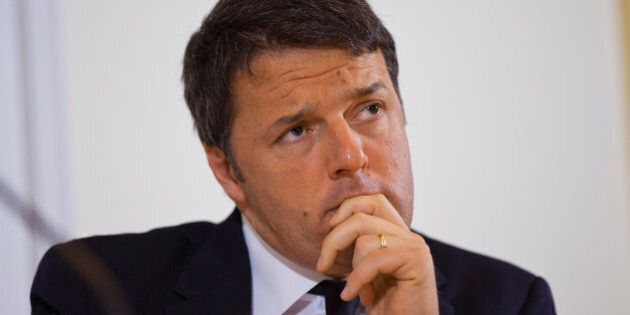 Italian Premier Matteo Renzi listens to a reporter's question during a press conference at Rome's foreign...