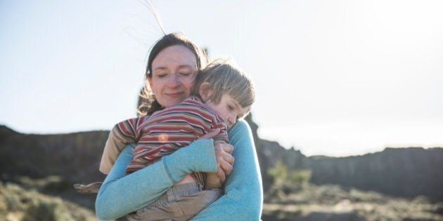 A mother holds her young son to comfort him after falling down whild hiking on the trails at Frenchmans...