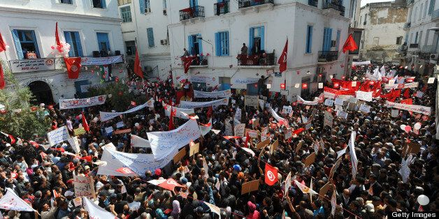 Tunisians protest outside the headquarters of the Union of Tunisian Workers during the May Day rally in Tunis on May 1, 2012.
