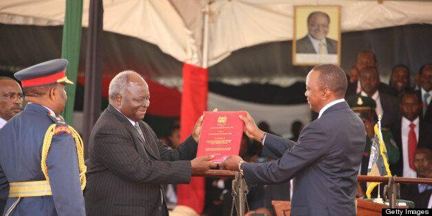NAIROBI, KENYA - APRIL 9: (KENYA, UGANDA, RWANDA and TANZANIA OUT) Outgoing President Kibaki hands over the Constitution of K