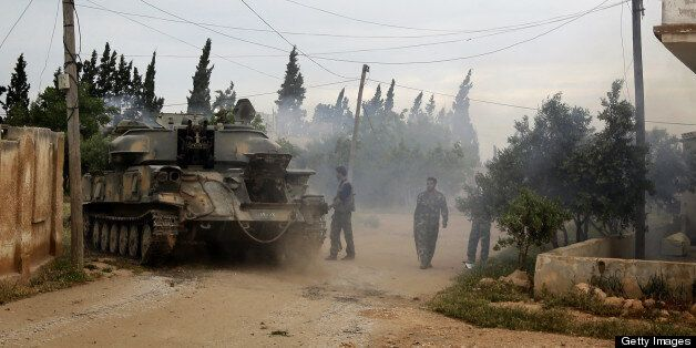 AFP EXCLUSIVE Syrian troops take control of the village of Western Dumayna, some seven kilometers north of the rebel-held cit