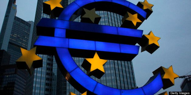 A euro sign sculpture stands outside the European Central Bank (ECB) headquarters in Frankfurt, Germany, on Tuesday, April 30, 2013. The ECB will cut its main refinancing rate 25 basis points to a record 0.5 percent on May 2, the median estimate from a Bloomberg survey of 66 economists shows, after gauges of business activity for April underscored weakness in the euro region. Photographer: Ralph Orlowski/Bloomberg via Getty Images