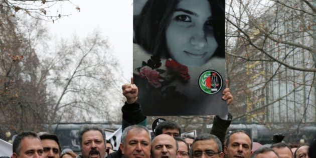 Thousands members of Turkey's Bar Associations with one holding a poster of Ozgecan Aslan, 20, a student,...