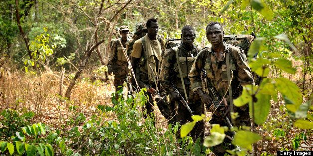 ADDITION / BYLINE TO GO WITH AFP STORY BY MAX DELANEY Ugandan soldiers patrol on April 18, 2012 through the central African j
