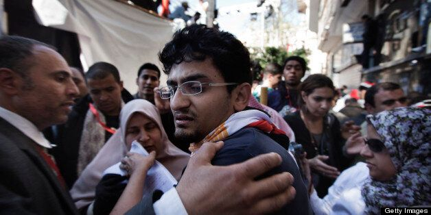 Google executive Wael Ghonim, who emerged as a leading voice in Egypt's uprising, reacts as he leaves the stage area after he