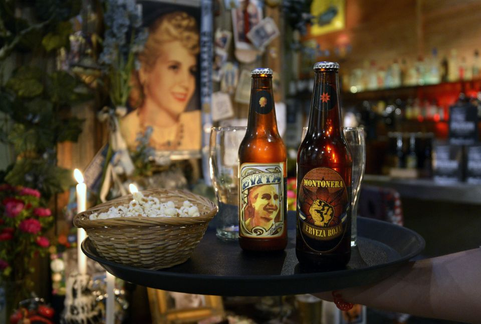 Bottles of Argentine craft beers 'Evita' and 'Montonera' are seen on a table at Peron Peron bar and restaurant, in Buenos Air