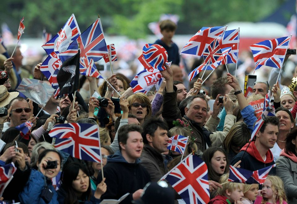 Crowds gather outside Buckingham Palace after the Royal Wedding of Prince William to Catherine Middleton on April 29, 2011 in