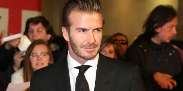 David Beckham poses for photographers upon arrival at the Pride of Britain Awards 2015 in London, Monday,...