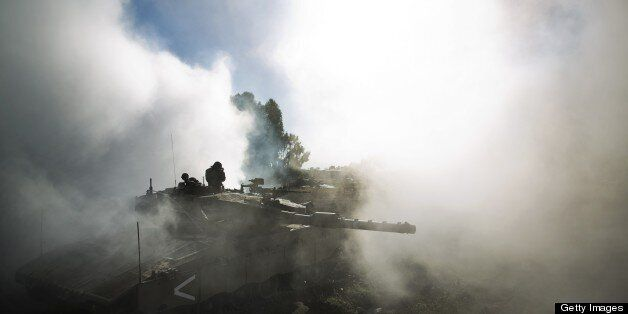 An Israeli army Merkava tanks maneuvers during a drill in the Israeli annexed Golan Heights near the border with Syria on May