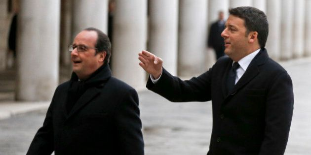 Italian Premier Matteo Renzi, right, shows the way to French President Francois Hollande, in Venice,...