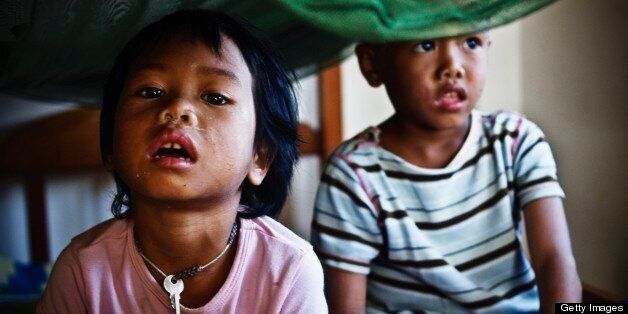 BATTAMBANG, CAMBODIA - 2007/12/01: Vimean, 4, and her younger brother Heng, 3, live at an orphanage. Vimean and Heng are both