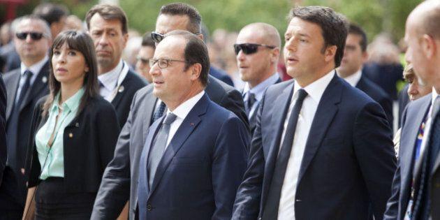 French President Francois Hollande, center, and Italian Prime Minister Matteo Renzi, right, arrive at...