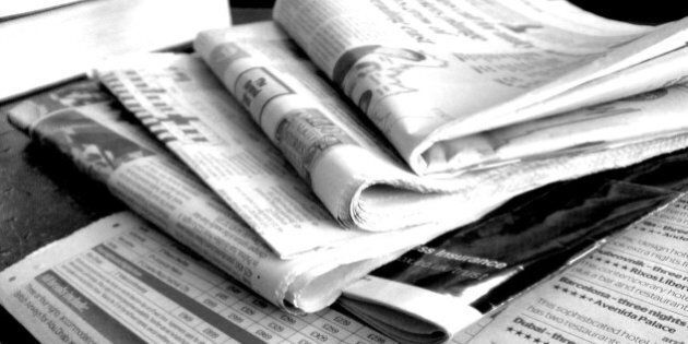 Newspapers in black and