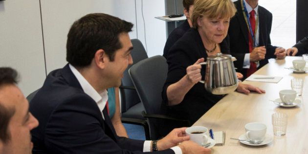 Greek Prime Minister Alexis Tsipras, left, and German Chancellor Angela Merkel are pictured during a...