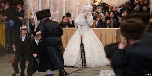 JERUSALEM, ISRAEL - MAY 22:   Tens of thousands of Ultra-Orthodox Jews of the Belz Hasidic Dynasty watch the the bride Hannah