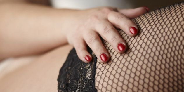 Close up, red nails and stockings, beautiful plus size