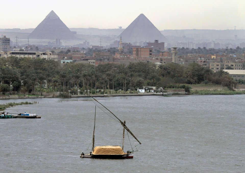 In this Tuesday, Jan. 22, 2013 file, a traditional felucca sailing boat carries a cargo of hay as it transits the Nile river
