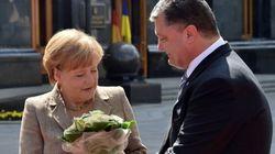 Merkel a Kiev, da sola contro i