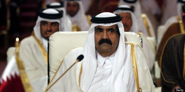 Qatar's Emir Hamad bin Khalifa al-Thani attends the opening of the Arab League summit in the Qatari capital Doha on March 26,