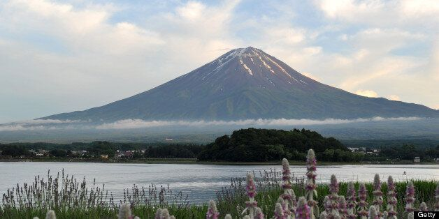 This picture taken on June 16, 2013 shows Mount Fuji, the highest mountain in Japan at 3,776 metres (12,460 feet), and Lake K