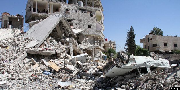 A picture shows destruction in Sbeneh, south of the Syrian capital Damascus, on June 16, 2013. More than 70 Syrian military o