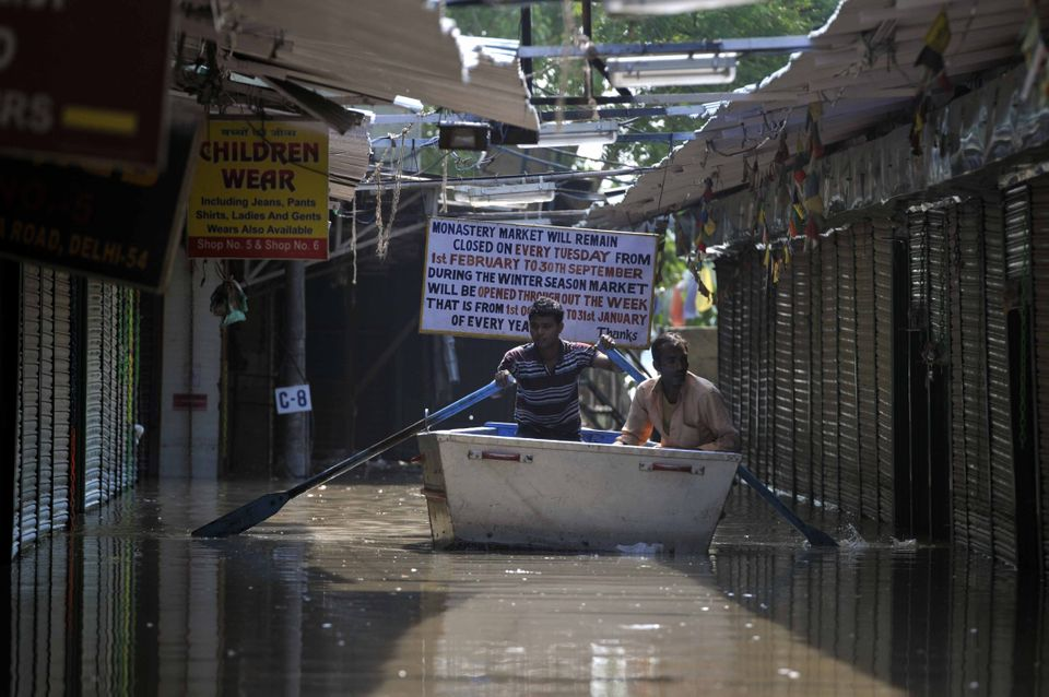 A rescue boat sailing through the water logged lanes during flood in river Yamuna on June 20, 2013 in New Delhi, India.  Low-
