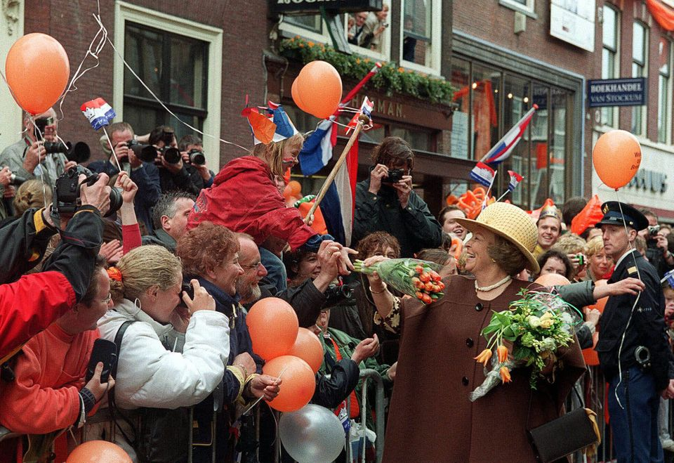 In this file photo, Dutch Queen Beatrix receives tulips during her visit to the western Dutch city of Leiden. Queen Beatrix a