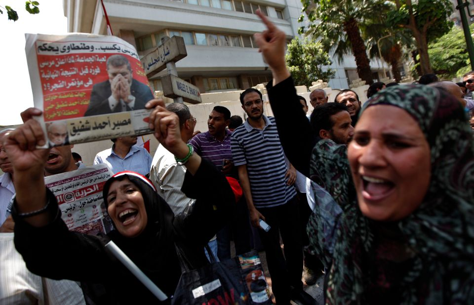 Egyptian protesters chant pro-Morsi slogans as they gather in front of the parliament building in Cairo, Egypt, Tuesday, July