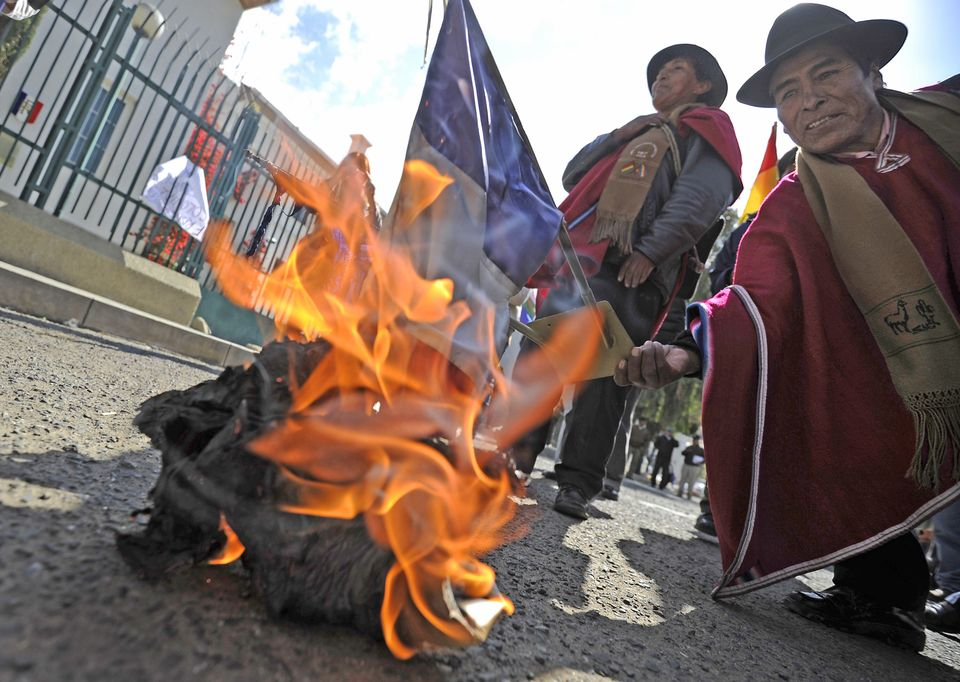 People burn a French flag in front of France's embassy in La Paz on June 03, 2013 . (JORGE BERNAL/AFP/Getty Images)