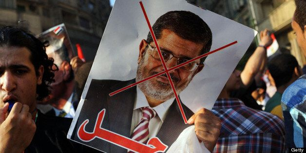 CAIRO, EGYPT - JULY 03:  An anti-President Mohammed Morsi poster is viewed as as thousands of Egyptian protesters celebrate i
