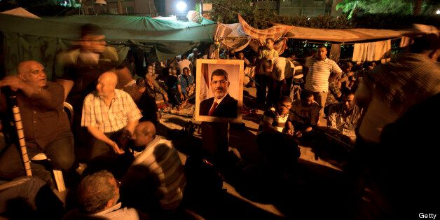 An Egyptian supporters of the Muslim Brotherhood prays on July 7, 2013 during a rally in support of deposed President Mohamed