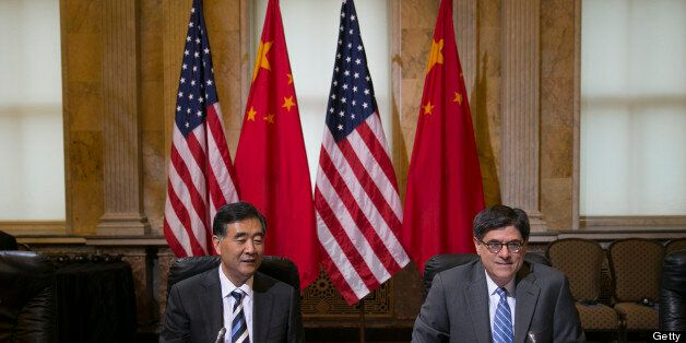Wang Yang, China's vice premier, left, and Jacob 'Jack' Lew, U.S. treasury secretary, attend a chief executive officer roundt